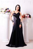 Beautiful brunette woman in elegant dress — Stock Photo