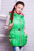 Little girl in autumn warm coat — Stock Photo
