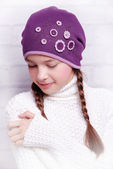 Child girl wearing knitted hat — Stock Photo