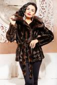 Brunette woman in fur coat — Stock Photo