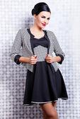 Beautiful brunette woman in elegant dress — Stockfoto