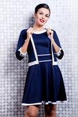 Pretty brunette woman in trendy dress — Stock Photo