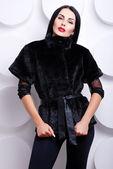 Woman in winter fur jacket — Stock Photo