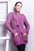 Pretty woman in knitted cardigan — Stock Photo