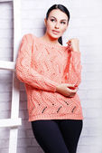 Pretty woman in knitted cardigan — Stockfoto