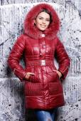Beautiful woman in coat with fur hood — Stock Photo