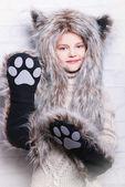 Smiling girl in furry animal costume — Stockfoto