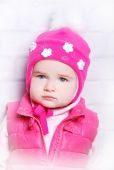 Child girl in warm knitted hat — Stock Photo