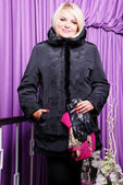 Blond woman in trendy coat — Stock Photo