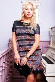 Blond woman in stylish elegant dress — Zdjęcie stockowe