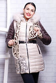 Brunette woman in winter coat with fur — Stock Photo