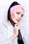 Pretty woman in headband — Stockfoto