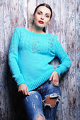 Brunette woman in trendy torn jeans — Stock Photo