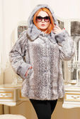 Plus size woman in winter fur coat — Stock Photo