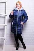 Woman in winter trendy coat — Stock Photo