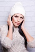 Beautiful woman in knitted hat — Stock Photo