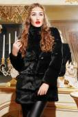 Beautiful woman in trendy fur coat — Stock Photo