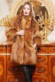 Beautiful woman in trendy fur coat — Stock Photo