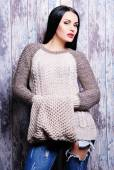 Woman in casual knitted sweater — Stock fotografie