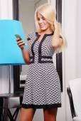 Beautiful blond woman in elegant dress — Stock Photo