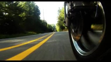 Big V-Twin Motorcycle Rumbling Down Two Lane Highway — Stock Video