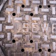 Vented Manhole Sewer Main Cover Asphalt Side Street Water Drain — Stock Photo #53782215