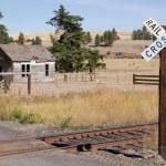 Railroad Crossing Sign Tracks Abandoned House Rural Ranch Farmland — Stock Photo #57466961