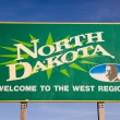 Welcom to North Dakota Highway Sign Bullet Holes — Stock Photo #71563703