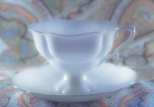 Beauty white porcelain cup with saucer  — Stock Photo
