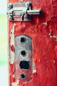 Old nice heck on old shabby door — Stock Photo
