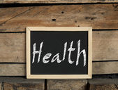 Healthy concept on blackboard — Stock Photo