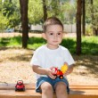 Little child boy plays with toy car — Stock Photo #54545983