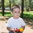 Little child boy plays with toy car — Stock Photo #54546055