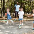 Children playing with soccer ball — Stock Photo #54546189