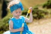 Little child girl with bubble blower — Stock Photo