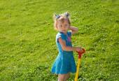 Little child girl on grass on meadow. — Stock Photo