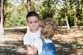 Baby boy and adorable child girl in park. — Stock Photo