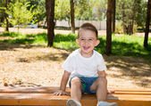 Cute little child boy in park — Stock Photo