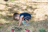 Little child boy with soccer ball in park — Stock fotografie