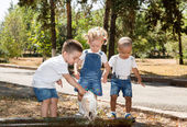 Group of happy children playing in park. — Stock Photo
