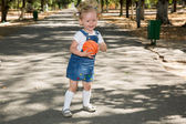 Little girl with soccer ball in park — Stock Photo