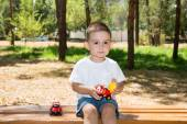Little child boy plays with toy car — Stock Photo