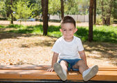 Cute little child boy in park on nature — Stock Photo
