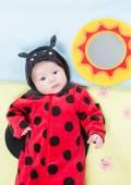 Baby girl in ladybug costume — Stock Photo