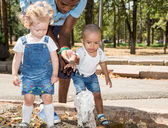Black man and Group of happy children — Stock Photo