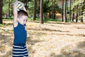 Little child boy with soccer ball in park — Stock Photo