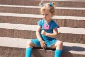Adorable little child girl on stairs — Foto de Stock