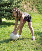 Adorable child girl with ball — Stock Photo