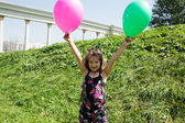 Child girl with balloons — Stock Photo