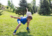 Boy with soccer ball in park — Stock Photo